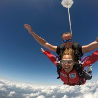 Luke Pinion Smiles while making a tandem skydive