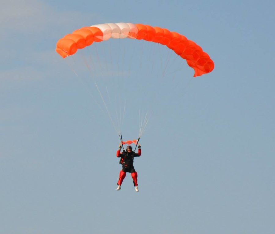 Mark flies his orange, skydiving parachute