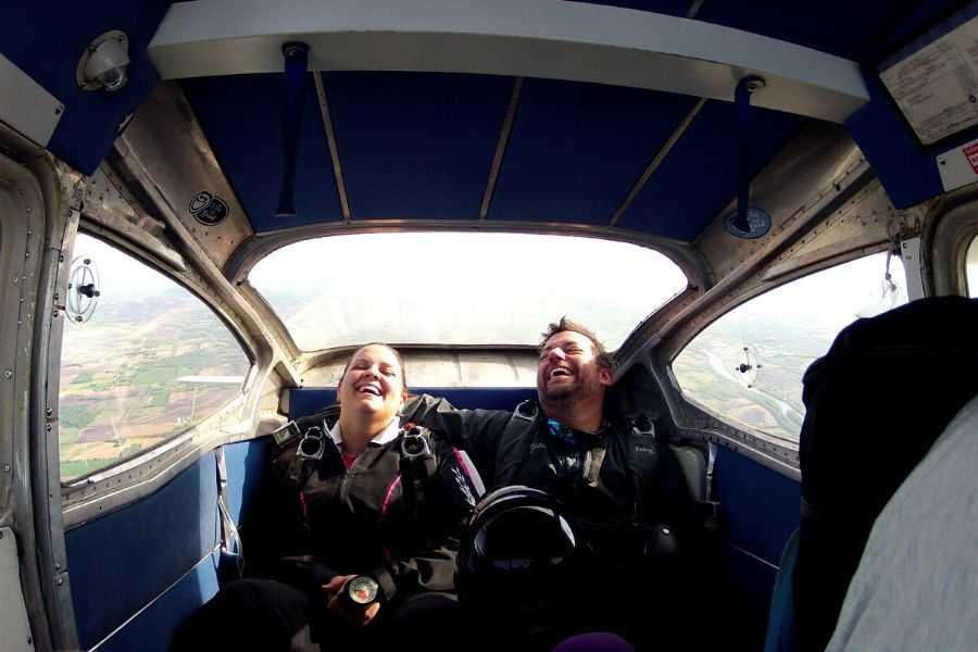 Jocelyn laughing in the plane.