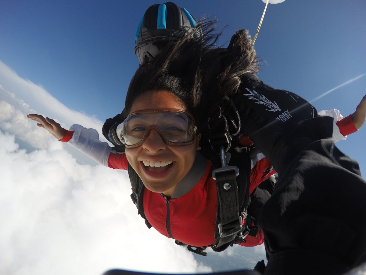 A girl smiles widely during free fall