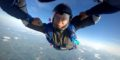 A licensed skydiver smiles during a solo freefall skydive at Wisconsin Skydiving Center near Chicago