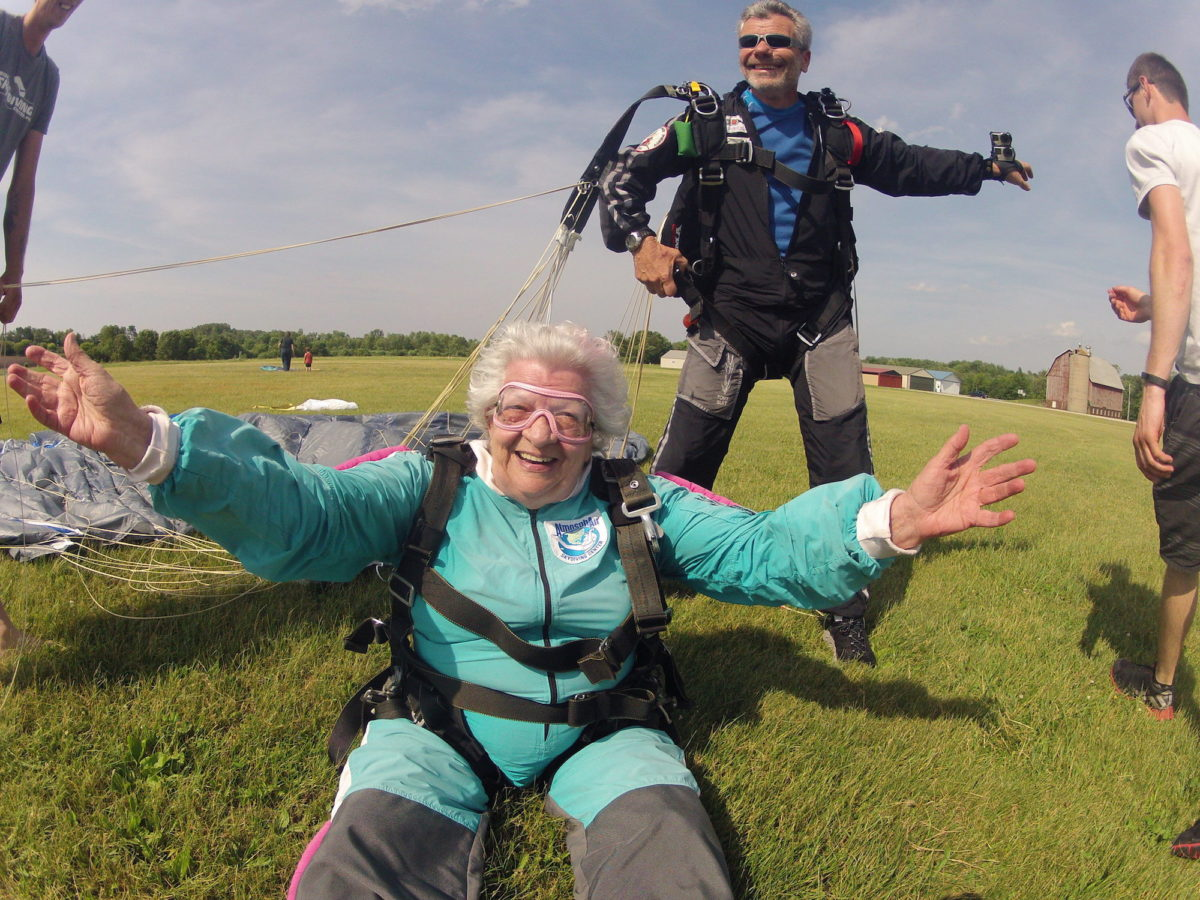 Anna Mae smiles widely after landing from her tandem skydive at Wisconsin Skydiving Center near Milwaukee