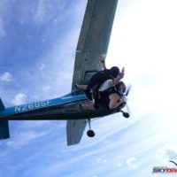 A tandem pair diving out of the Cessna 182 at 12,000'