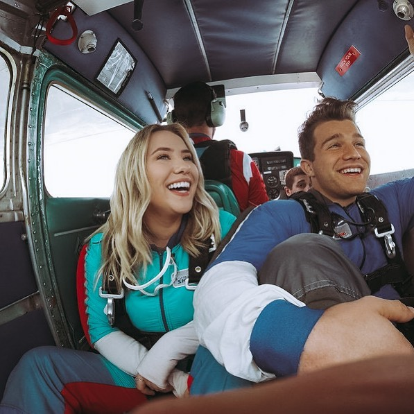 The cost of skydiving is worth it - Couple smiling in a plane as they prepare to jump out for AFF training at Wisconsin Skydiving Center near Chicago