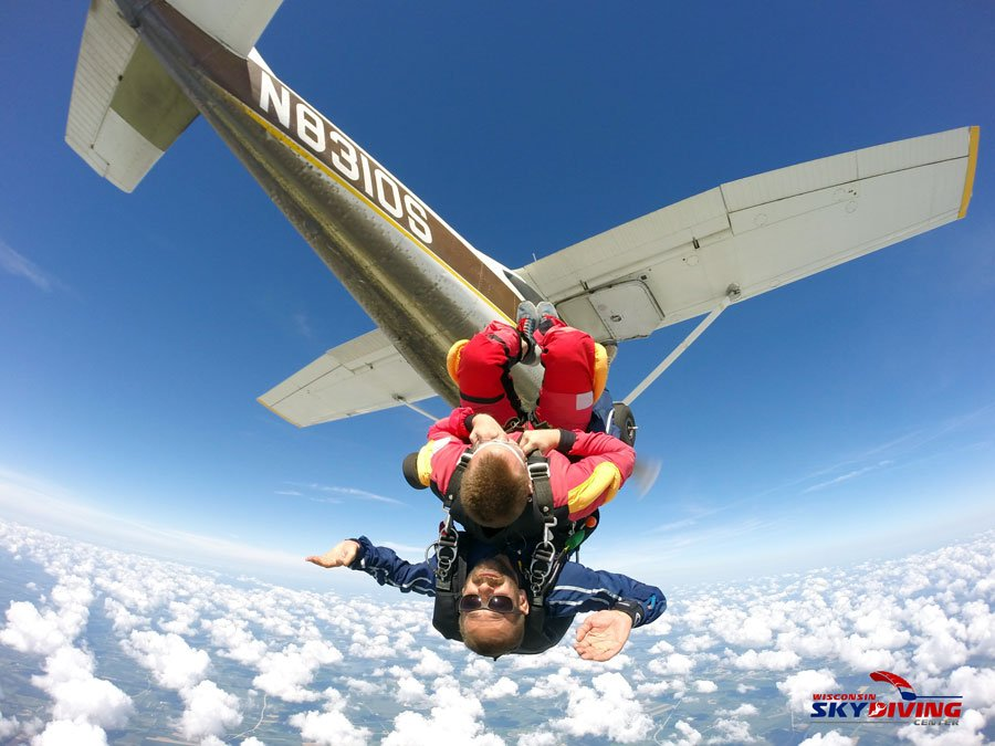 Jumping out of a plane upside down and doing flips above the clouds at Wisconsin Skydiving Center near Milwaukee