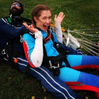 Girl excited after finishing her first skydive at Wisconsin Skydiving Center near Milwaukee