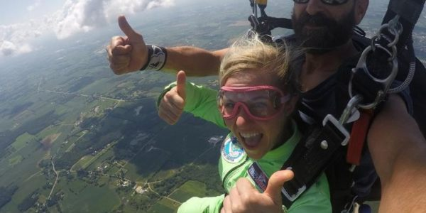 Girl gives thumbs up after finishing a skydive at Wisconsin Skydiving Center near Milwaukee
