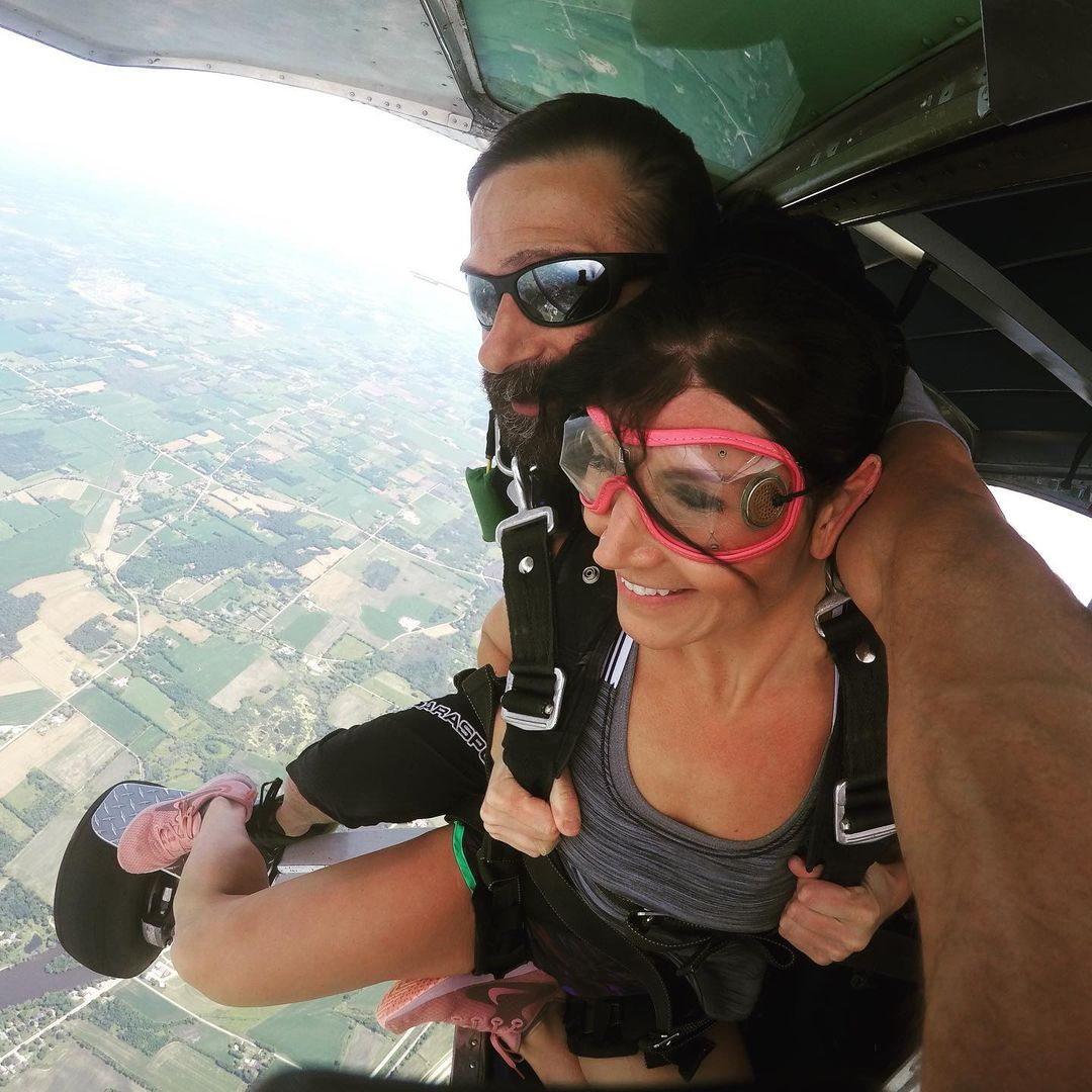 Woman preparing to jump out of a plane at Wisconsin Skydiving Center near Madison