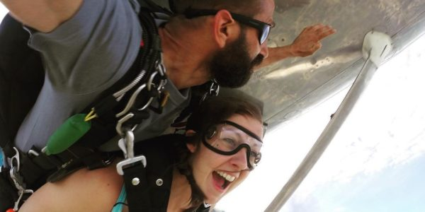Woman not scared while coming for the first time out of a plane at Wisconsin Skydiving Center near Madison