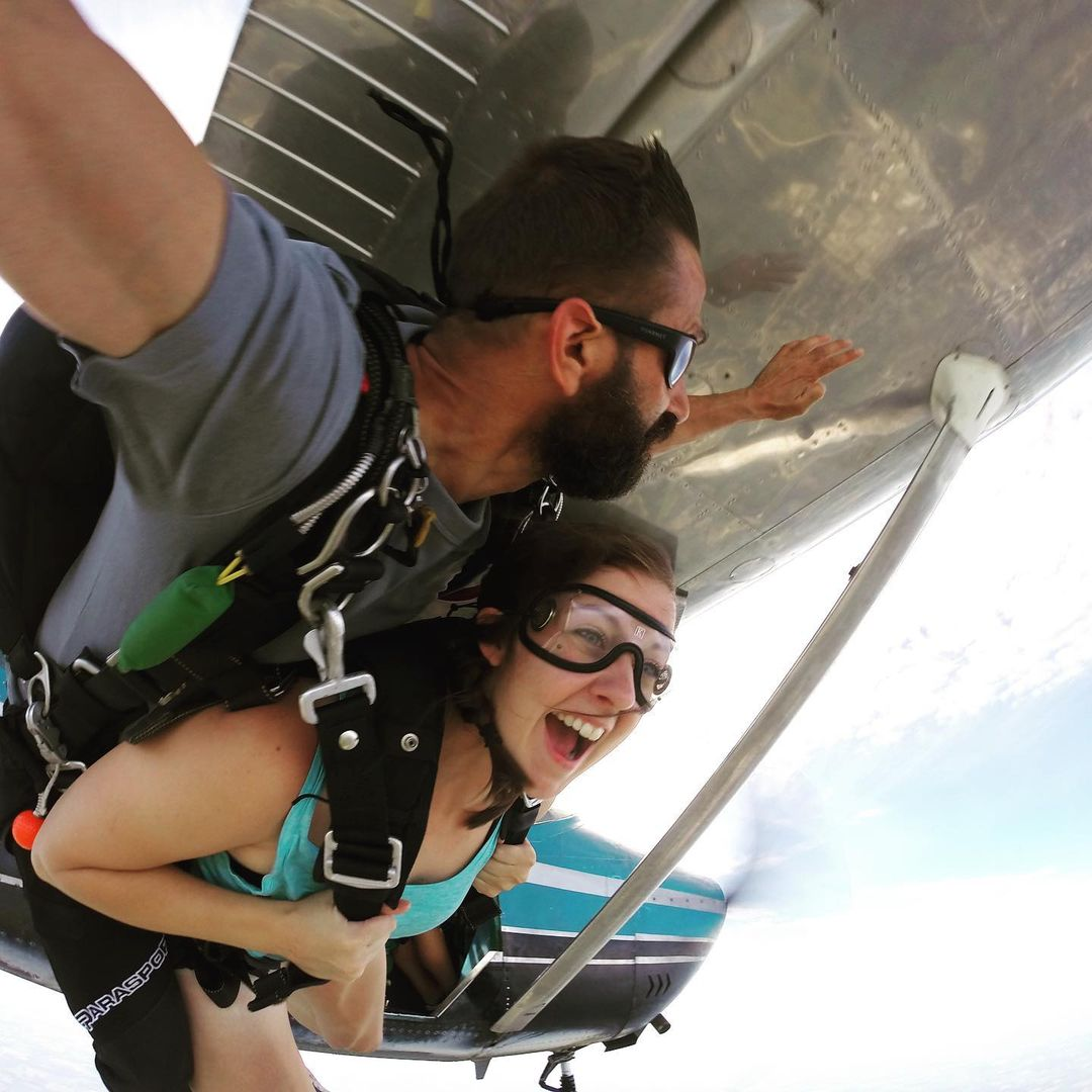 Woman smiling while coming for the first time out of a plane at Wisconsin Skydiving Center near Madison