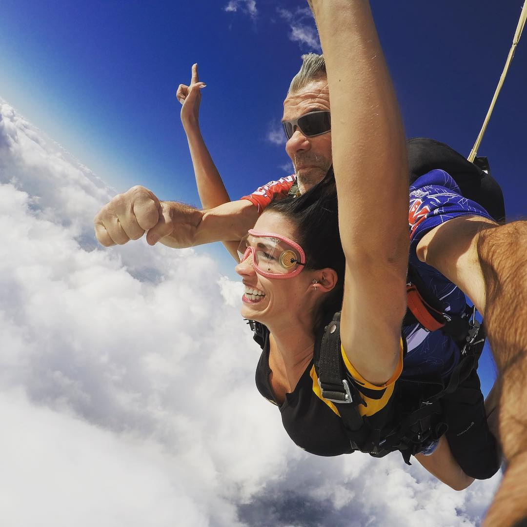 Woman with a big smile spreading her arms to fly at Wisconsin Skydiving Center near Milwaukee