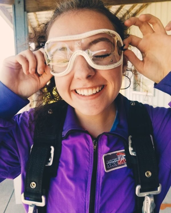 Girl smiling before a tandem skydive at Wisconsin Skydiving Center near Chicago