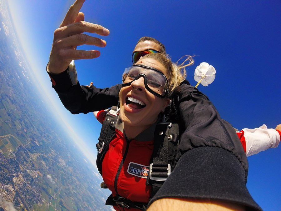 emmycoop smiling with joy during freefall at Wisconsin Skydiving Center near Milwaukee