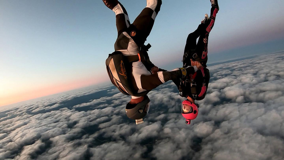 Couple freeflying above the clouds at Wisconsin Skydiving Center near Chicago