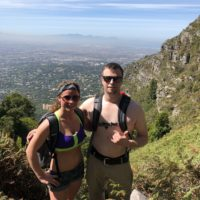 Shirtless couple hiking in South Africa