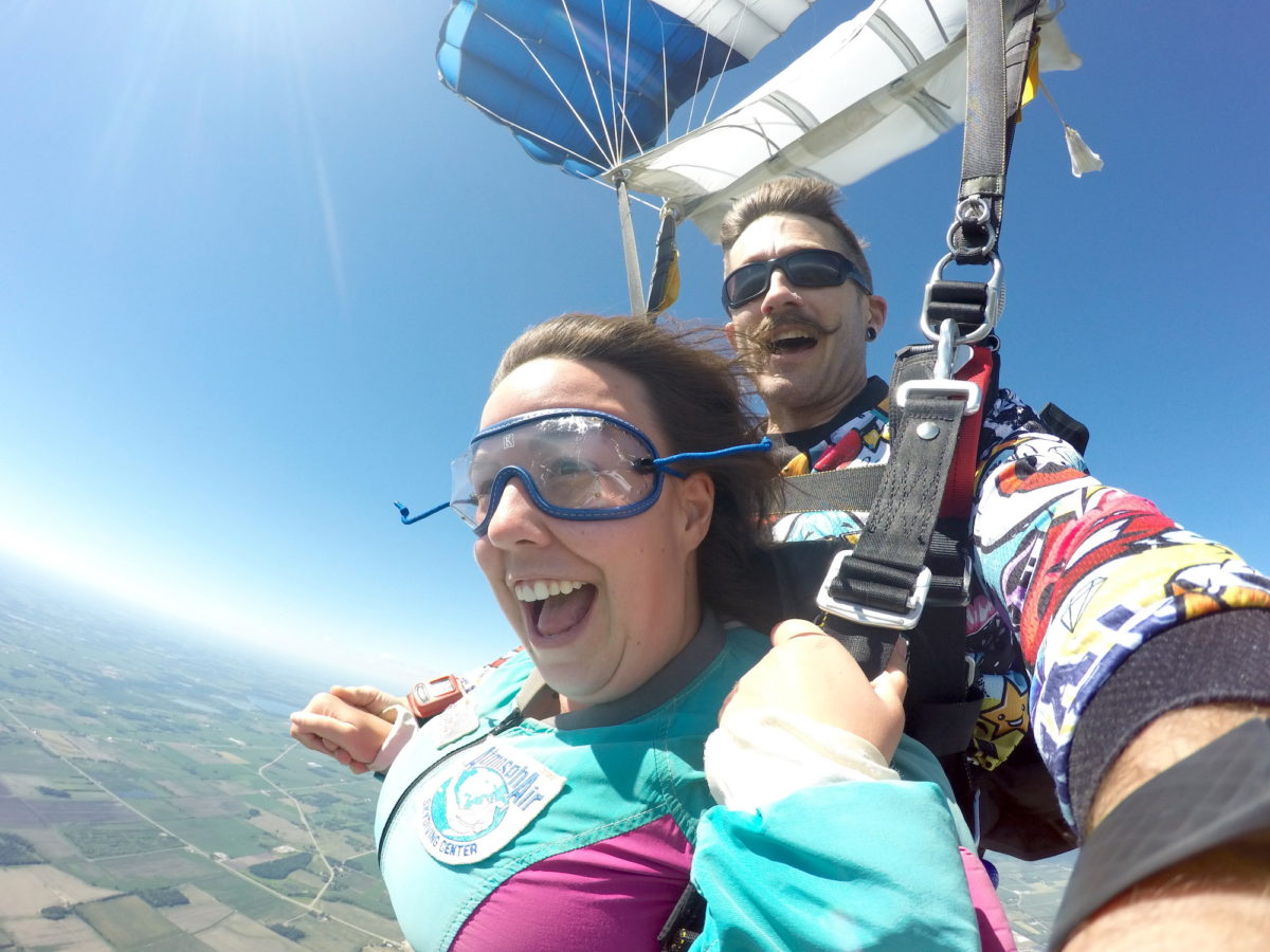 Girl smiling after a tandem skydive at Wisconsin Skydiving Center near Chicago