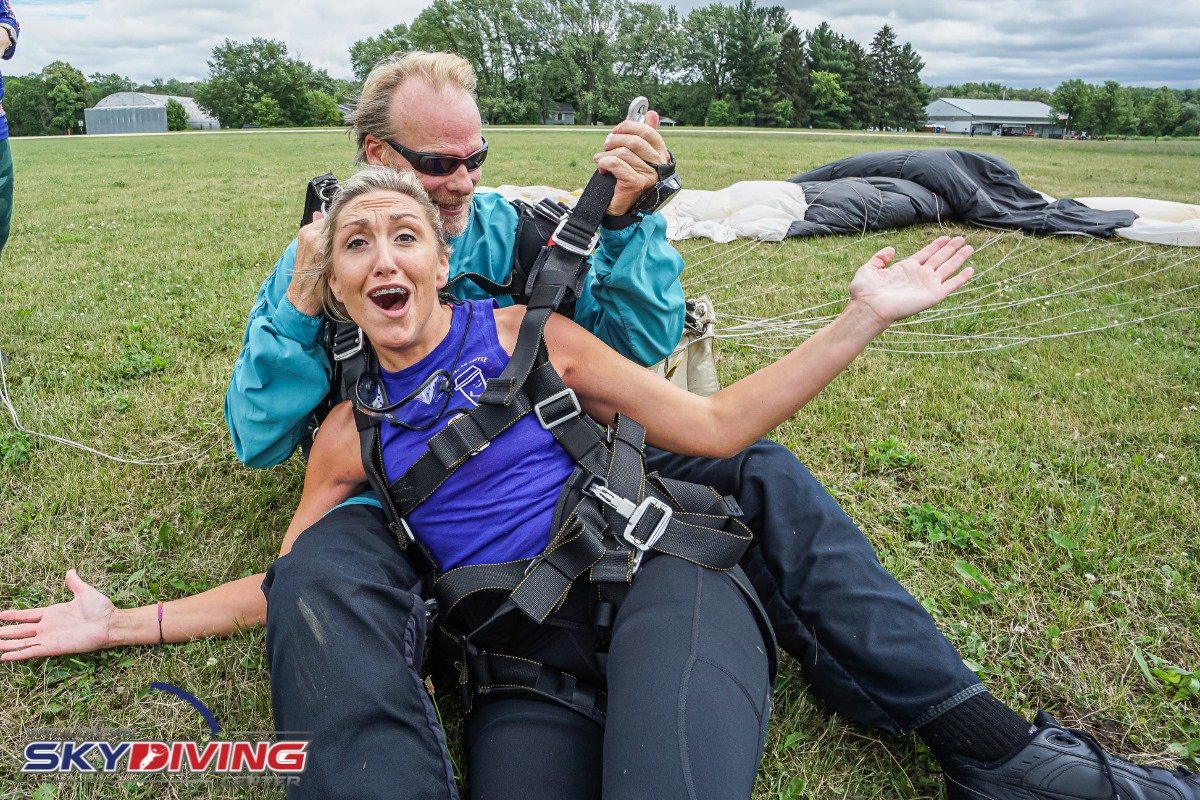 Woman excited and smiling after her first tandem skydive at Wisconsin Skydiving Center near Chicago