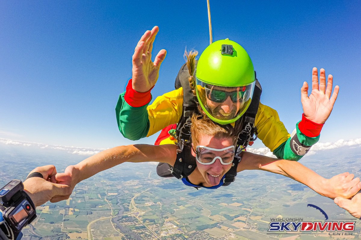 Woman skydiving in tank top and instructor wearing glasses at Wisconsin Skydiving Center near Chicago