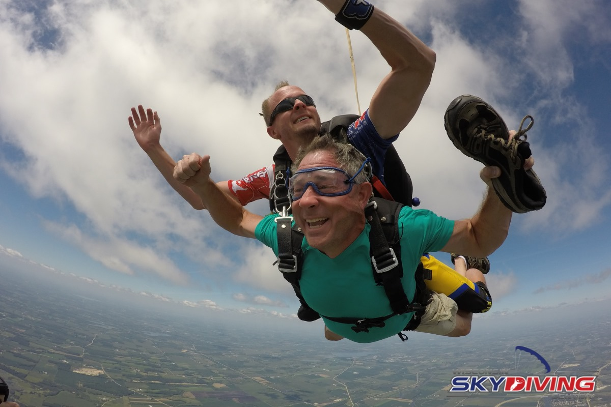 Man holding his shoe during skydiving freefall at Wisconsin Skydiving Center near Chicago