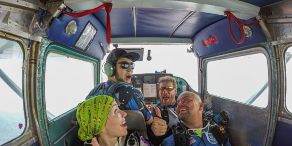 Tandem skydivers and instructors preparing to reach altitude at Wisconsin Skydiving Center near Chicago